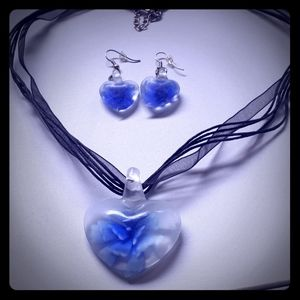 Blue flower in heart shape necklace